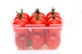 Cherry tomatoes in a plastic container on white background Stock Image