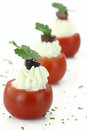 Cherry tomatoes stuffed with cheese cream Stock Photos