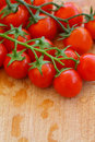 Cherry tomatoes vegetables on background Royalty Free Stock Images