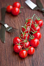 Cherry tomatoes on wooden table Stock Images