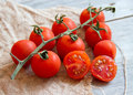 Cherry tomatos on wood and burlap Royalty Free Stock Photo