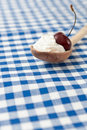 Cherry in whip cream Stock Photography