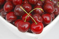 Cherry in the white bowl Stock Images