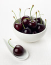 Cherry white spoon, cherries group white bowl Stock Photography