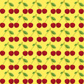 Cherry on a yellow background Stock Images
