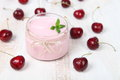 Cherry yogurt and ripe cherry Royalty Free Stock Photo