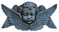 Cherub a face with wings made out of stone Stock Photos