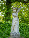 Cherub in the gardens of castle de haar the netherlands medieval dutch province utrecht Stock Image