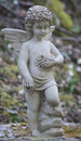 Cherub statue of in the park of a castle Royalty Free Stock Photography