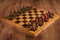 Chess battle catolic and slav on wooden texture table Royalty Free Stock Images