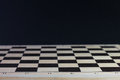 Chess board with chess pawns. Checkerboard black background. Royalty Free Stock Photo