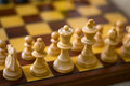 Chess figures on a chess board white in the foreground Royalty Free Stock Photo