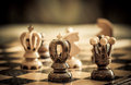 Chess with focus to black king in front Royalty Free Stock Photo