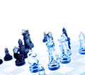Chess game of glass pieces Royalty Free Stock Photo