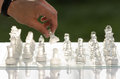 Chess game man hand moving a piece Stock Images
