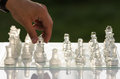 Chess game man hand moving a piece Royalty Free Stock Images