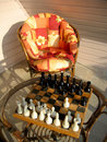 Chess game table and chair Stock Photos