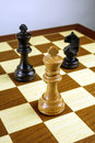 Chess king against pawns black wooden only before the danger Stock Photography