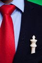 Chess king in the pocket of a business man Royalty Free Stock Photos