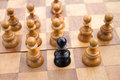 Chess leadership concept black pawn on the board Royalty Free Stock Photos