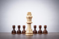 Chess leadership concept over grey background on the Royalty Free Stock Photo