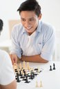 Chess move excited teenager contemplating his next Royalty Free Stock Image