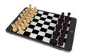 Chess over tablet pc chessboard on a white background Royalty Free Stock Photography