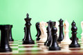 Chess pieces on board. Focus on the black king Stock Photography