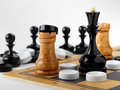 The chess pieces and checkers placed on the chessboard.