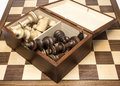 Chess pieces in open storage box on chess board showing players Royalty Free Stock Images