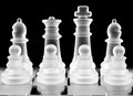 Chess pieces over black Stock Photos