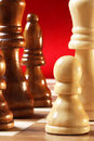 Chess Pieces on Red Royalty Free Stock Image