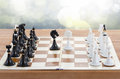 Chess ready to play with two knights in front on blue Stock Photos