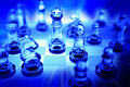 Chess set in blue Royalty Free Stock Photo