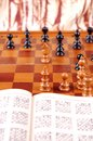 Chess table and chess book Stock Images