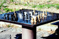 Chess table and chessman in the park, for active seniors Royalty Free Stock Photo