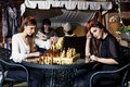 The chess two beautiful women play and think about strategy Stock Images