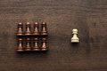 Chess uniqueness concept over grey background Royalty Free Stock Photo