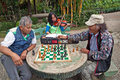 Chess and violin baguio city philippines july two unidentified men play while a young unidentified girl practices playing in Stock Photo