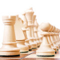 Chess on white. Royalty Free Stock Photos