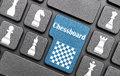 Chessboard blue key on laptop Stock Photo