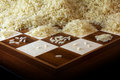 Chessboard with growing heaps of rice grains, legend about the e Royalty Free Stock Photo