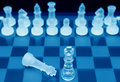 Chessboard pieces blue glass crystal with a fallen king in this success victory concept Stock Images