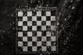 Chessboard under the rain close up view Royalty Free Stock Photos