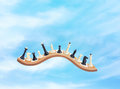 Chessmen in the sky on waved board Stock Photo