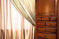 Chest of drawers and curtain Royalty Free Stock Photography