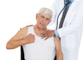 Chest examination closeup cropped portrait doctor performing heart lungs physical exam listening with stethoscope on elderly Royalty Free Stock Photo