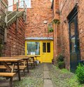 stock image of  CHESTER, ENGLAND - MARCH 8TH, 2019: Porta, a smal local store in Chester