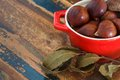 Chestnut and bay leaf on table Royalty Free Stock Photo