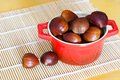 Chestnut in red bowl fresh on table Stock Photo